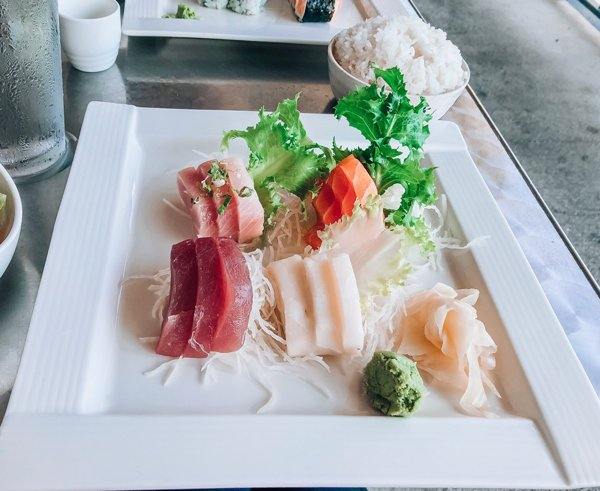 Zen Sushi Asheville North Carolina Sashimi lunch special with tuna, salmon, yellowtail, and whitefish sashimi next to a bowl of white rice.