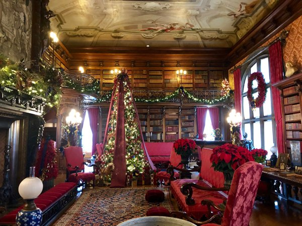 Biltmore Library Asheville NC at Christmas with old leather bound books and Christmas decorations like a tree