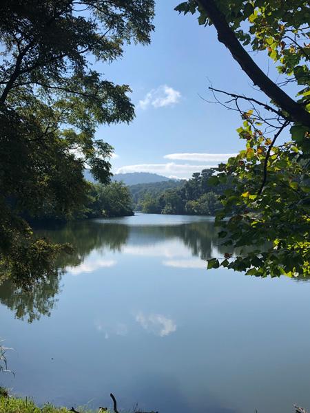 Beaver Lake Perimeter Trail and Bird Sanctuary Asheville North Carolina lake with trees and Blue Ridge Mountains