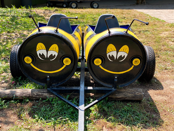 Sky Top Orchard NC Bee Train with two barrels turned and cut open for a seat in the shape of bees