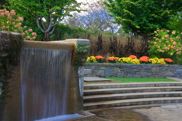 Best Hiking In Asheville North Carolina Arboretum with steps, flowers, and fountain