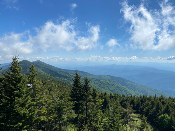 Mount Mitchell Hiking Trails with blue and green mountains with trees
