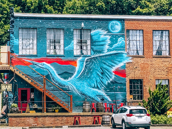 Asheville NC Things To Do River Arts District Heron mural on brick building