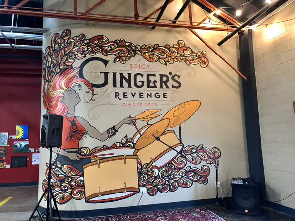 Gingers Revenge Asheville NC with mural of woman playing the drums