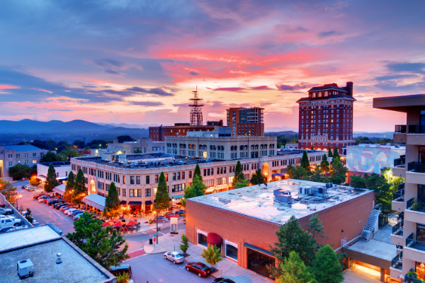 Historic Downtown Asheville North Carolina with Grove Arcade at sunset