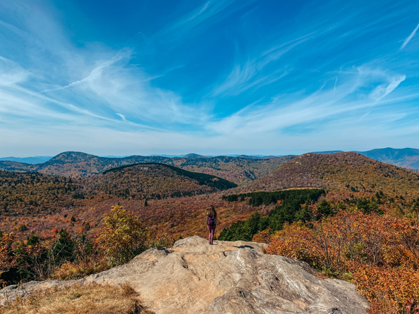 Sam Knob at Black Balsam with brunette white girl in a pink hiking backpack