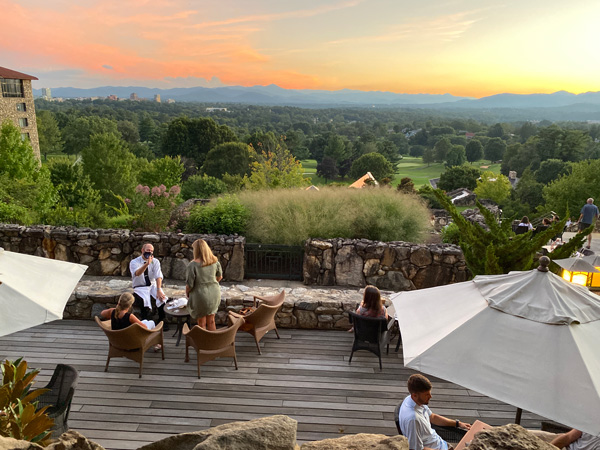 Sunset Terrace at Omni Grove Park Inn Asheville NC with tables and sunset over Asheville and mountains