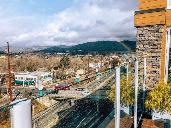 The Montford Rooftop Bar Asheville NC with rainbow and view off balcony
