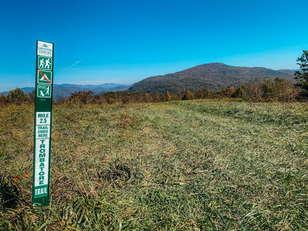 Trombatore Trail End Blue Ridge Pastures with sign and mountains