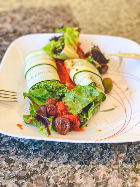 Asheville takeout Laughing Seed Cafe with vegan manicotti, lettuce, kalmata olives, and sun dried tomatoes