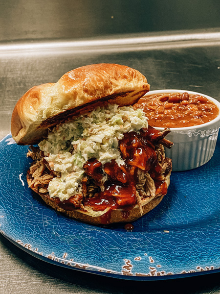 Big South Kitchen BBQ Curbside Pickup with BBQ pulled pork sandwich and baked beans