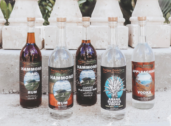 Dalton Distillery Asheville with bottles of rum, coffee-flavored rum, and vodka