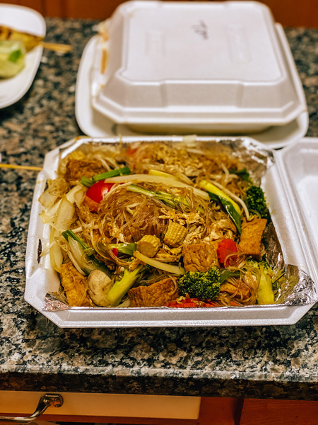Delivery in Asheville Siam Thai noodles in takeaway container with greensand sprouts
