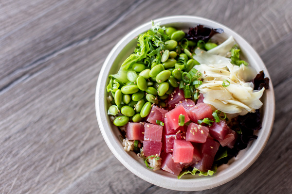 Delivery in Asheville Yum Poke Spot poke bowl with edamame, tuna, and ginger