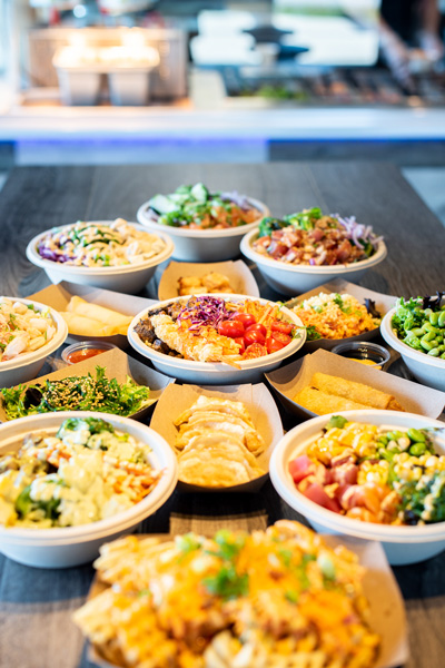 Takeout in Asheville Yum Poke Spot with poke bowls, spring rolls, and salad