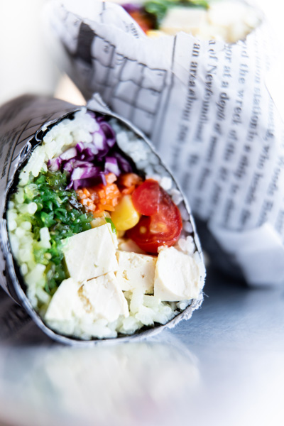 Yum Poke Spot Sushi In Asheville NC picture of sushi burrito wrapped in paper