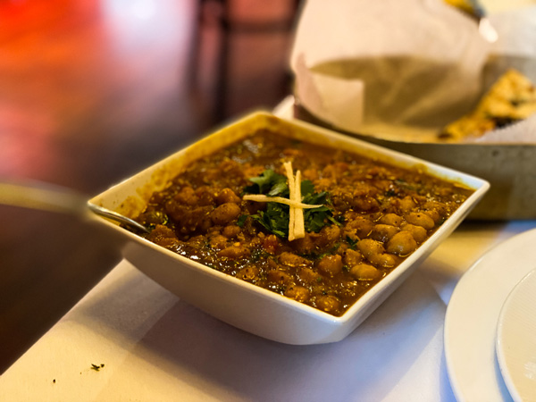 Andaaz Indian Food Asheville with bowl full of spicy lentils and garnish
