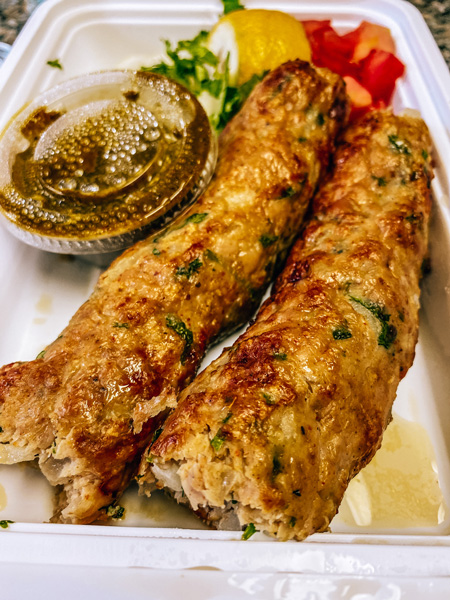 Biryani Pakistani Indian Food Asheville with meat sausage skewers