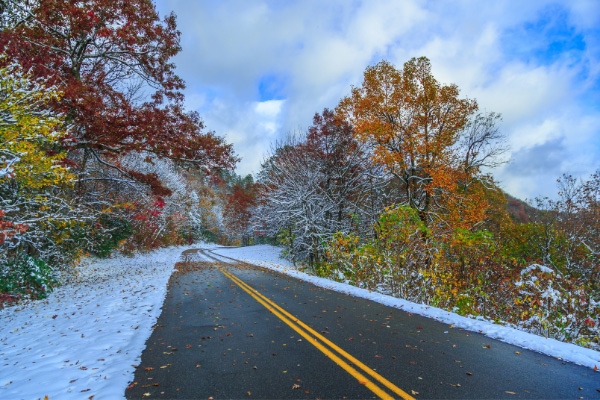 Blue Ridge Parkway Winter Road with snow and fall foliage trees