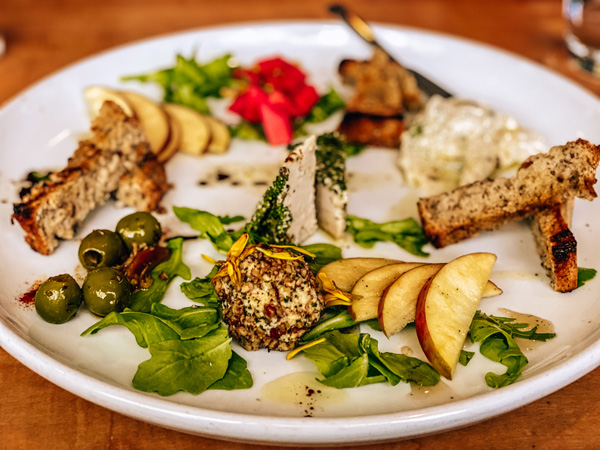 Cheese Plate Plant Asheville NC with olives, vegan cheeses, beets, and bread