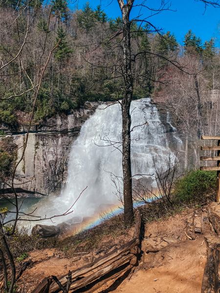 Rainbow Falls NC with rainbow over waterfalls and dirt trail