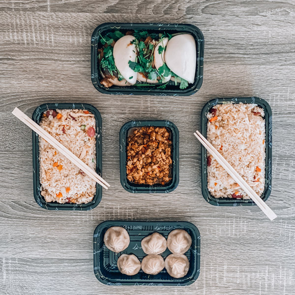 Red Ginger Dimsum and Tapas Takeout with 5 containers of rice, dumplings and Asian fusion takeout