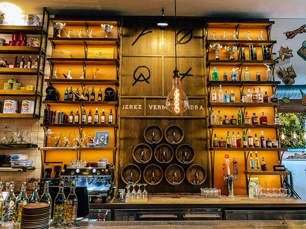 Sherry Bar Curate Restaurant Asheville with bottles and sherry taps