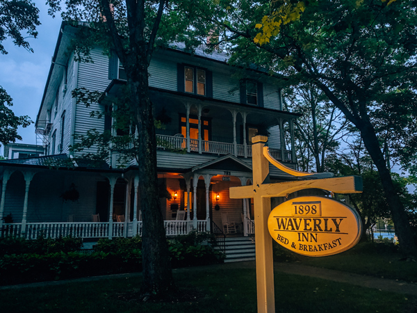 1898 Waverly Inn Hendersonville NC Bed and Breakfast white house with gray blue shutters at night