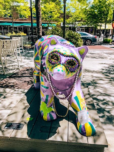 Historic downtown Hendersonville Mardi Gras purple bear sculpture