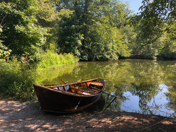 Picnic Biltmore Estate with picture of fly fishing boat at Lagoon