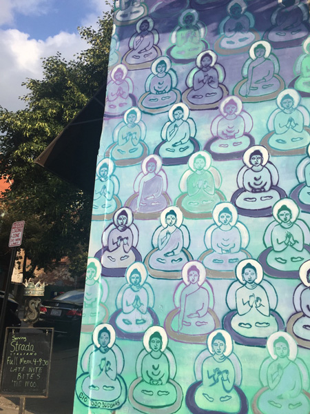 10000 Buddhas Asheville Murals with blue purple and green buddhas