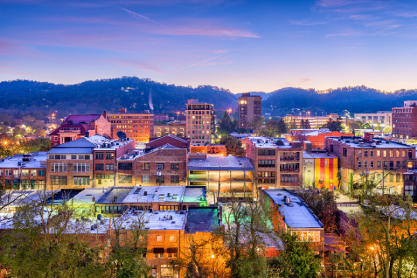 Best Asheville Neighborhoods Downtown cityscape at night