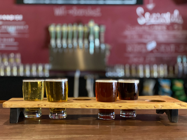 Brevard Brewing Company with flight of lagers and pilsners at bar in taproom