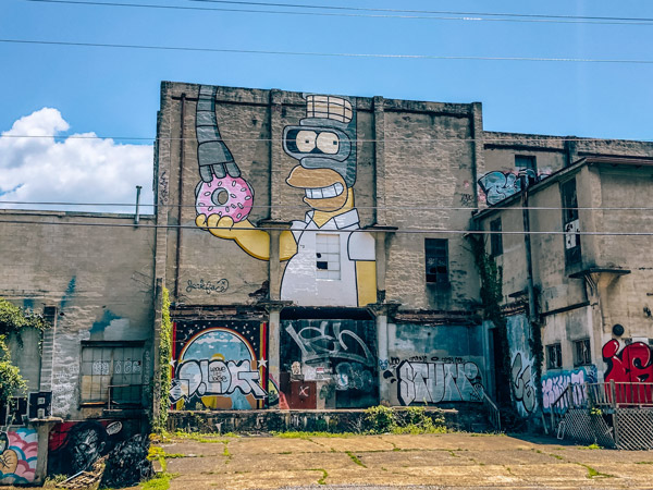 Fender Bender Mural Asheville NC with Homer Simpson holding donut mixed with Bender from Futurama by Jerkface