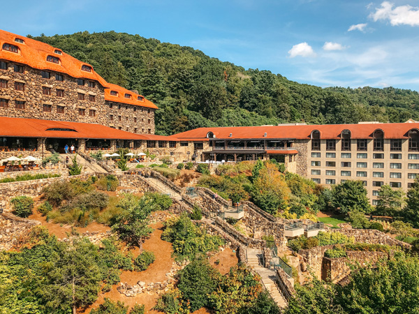Omni Grove Park Inn North Asheville Neighborhood with large stone resort, orange roof, and patio