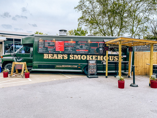 Bear's Smokehouse Asheville NC permanent food truck in parking lot with restaurant behind it