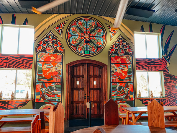 Burning Blush Brewery Taproom with Victorian era seating and murals