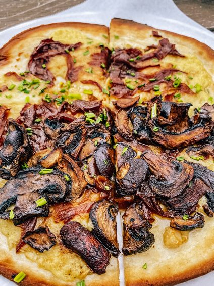 Grata Pizzeria UpCountry Brewing West Asheville sliced pizza with mushrooms