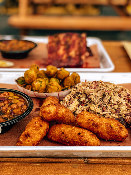 Luellas BBQ Asheville NC with with pulled pork, hushpuppies, fried okra, and beans