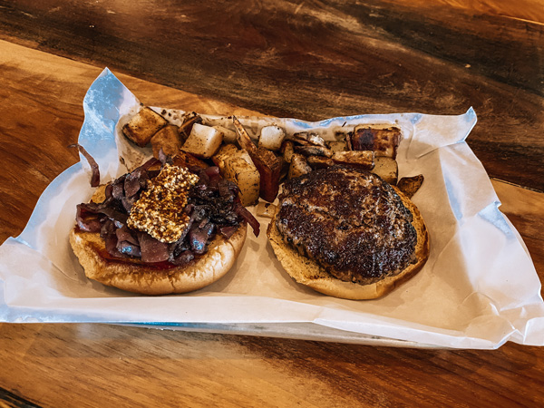 The Burger Barn Parker Binns Vineyards with open faced burger with onions and potatoes