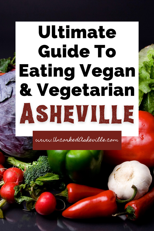 Vegetarian Vegan Asheville Guide Pinterest Pin with picture of raw vegetables like carrots, garlic, tomatoes, peppers, and lettuce
