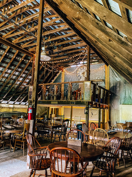 Baker Buffalo Creek Vineyard Winery Barn on second story with lights, tables, and chairs