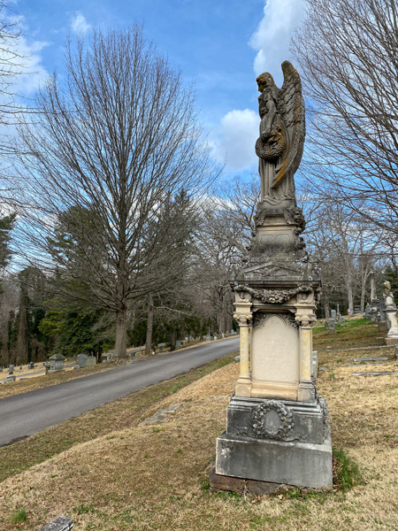 Buchanan Angel monument in Riverside Cemetery with Angel looking out over paved road