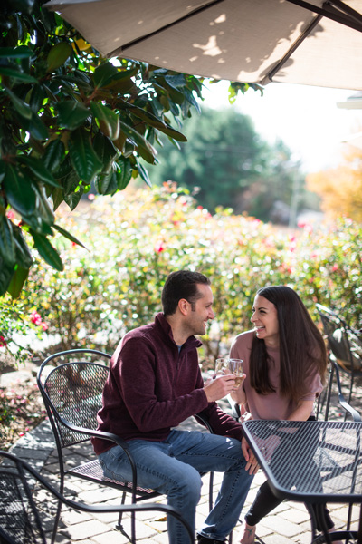 Burntshirt Vineyards Hendersonville NC with white brunette male and female sitting at a table