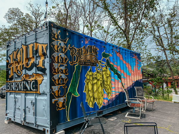 Lookout Brewing Company with chairs, urban art with local and hops on container