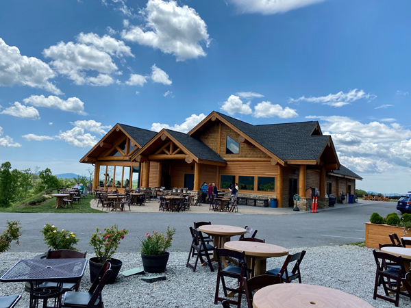 Point Lookout Vineyards Near Asheville NC with tasting room, outdoor tables and seating, and paved road