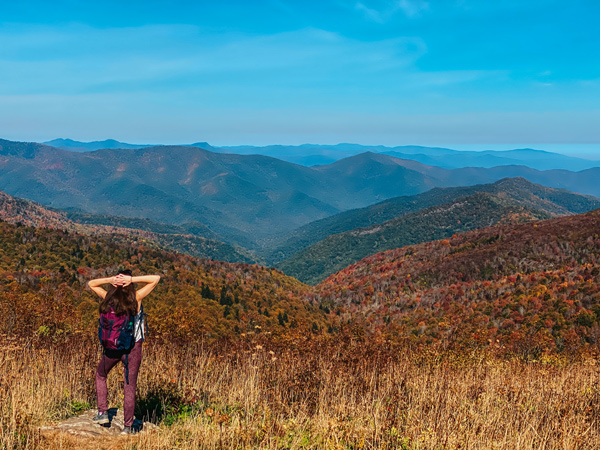 Blue Ridge Parkway Hikes Black Balsam Art Loeb with white brunette woman with backpack looking out at mountains