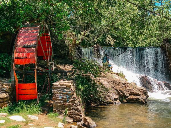Dam Waterfall Reems Creek Weaverville NC with red water wheel