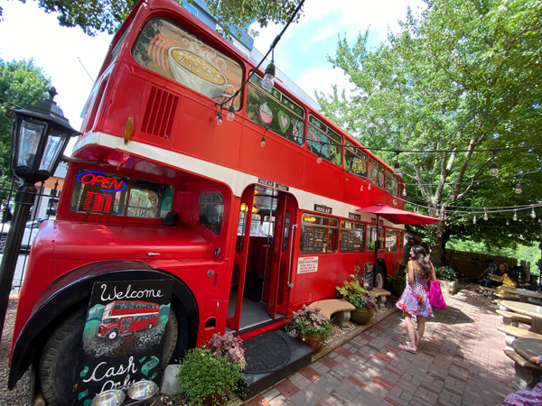 Double Ds Coffee and Desserts Asheville NC with double decker vintage red bus converted into coffee shop