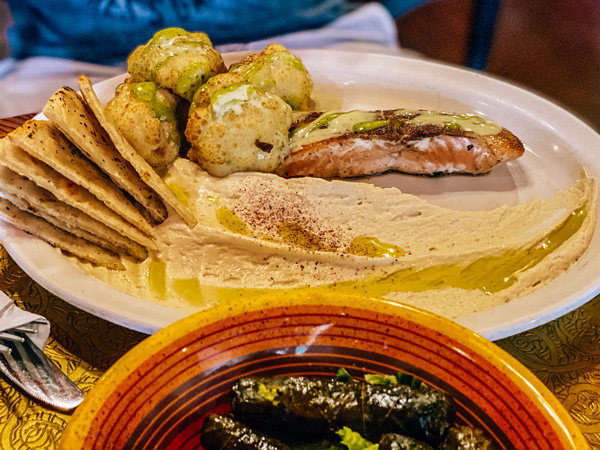 Jerusalem Garden Cafe Downtown Asheville NC with grape leaves and salmon with hummus, meatballs, and pita